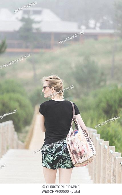 Portugal, Viana do Castelo , back view of tourist on footbridge