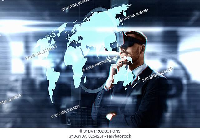businessman in virtual headset with world map