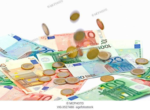 Euro coins falling on euro banknotes, raining money - 20/03/2011
