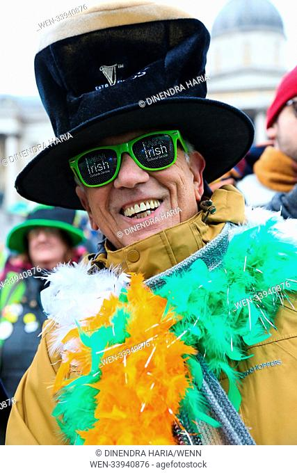 People celebrates St Patrick's Day in Trafalgar Square. Saint Patrick's Day, or the Feast of Saint Patrick, is a cultural and religious celebration normally...