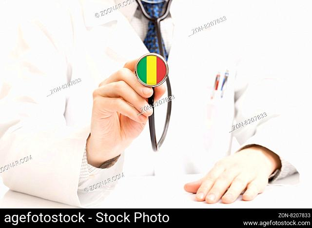 Medical doctor with stethoscope in his right hand