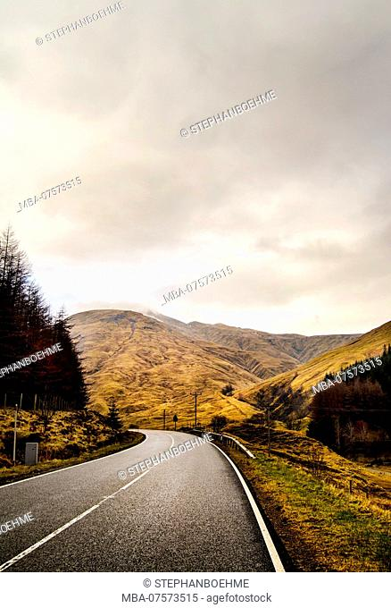 Country road in typical mountain landscape, Highlands, Scotland
