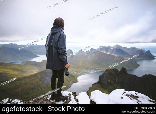 Young man hiking on mountain in Norway