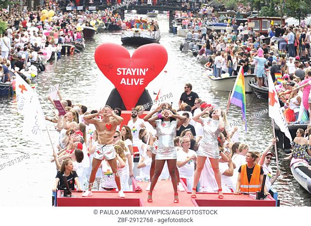 Revelers on the boat in the Prinsengracht canal participating in the Amsterdam Canal Parade during Amsterdam Gay Pride on August 5 , 2017 in Amsterdam