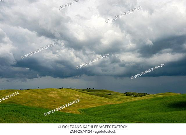 Storm clouds over fields near San Quirico in the Val d'Orcia near Pienza in Tuscany, Italy