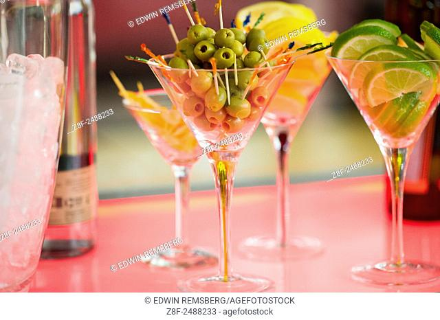 Martini glasses filled with ingredients to mix drinks in Ellicott City, Maryland. USA