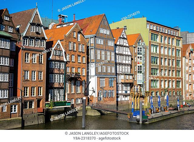 Old houses along the Nikolaifleet canal on a sunny afternoon, Altstadt, Hamburg, Germany
