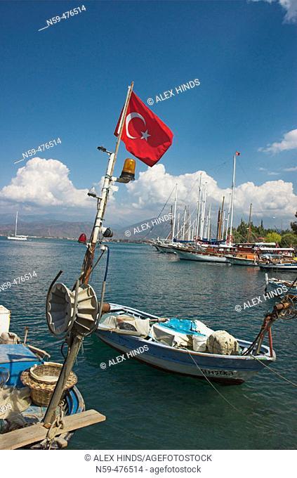 Fishing boats and Turkish flag at Fethiye, Turkey