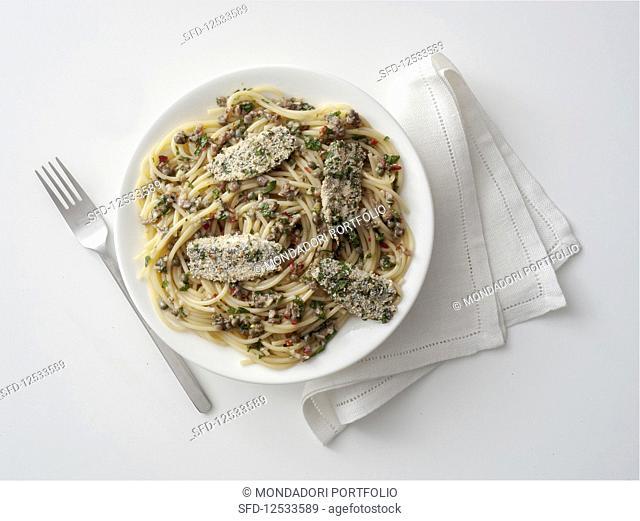Pasta con salmoriglio (spaghetti with salmoriglio sauce and anchovies, Italy)