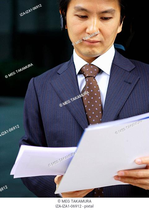 Close-up of a businessman reading documents