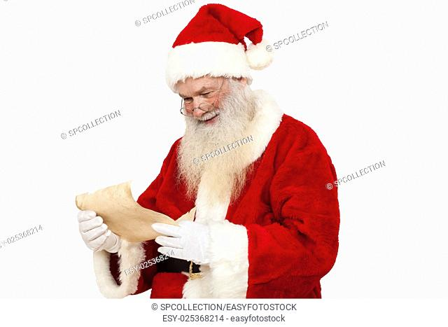 Santa Claus reading a wish list (isolated)