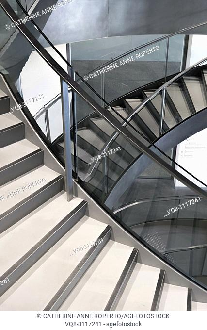 Knife edge stair revolutions in glass and chrome spiralling downwards at the Roman Museum, Nimes, Provence, France