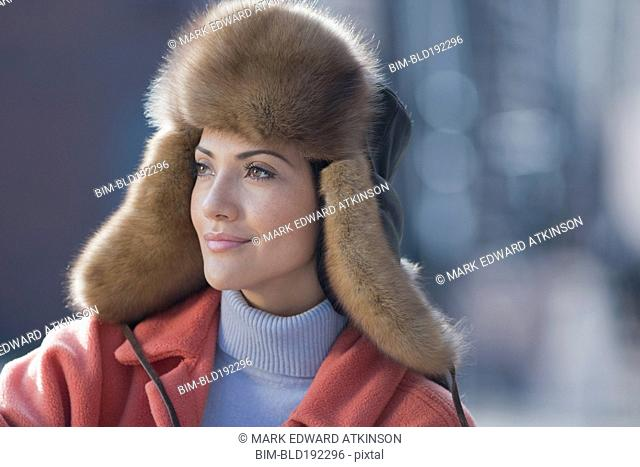 Hispanic woman wearing fur hat