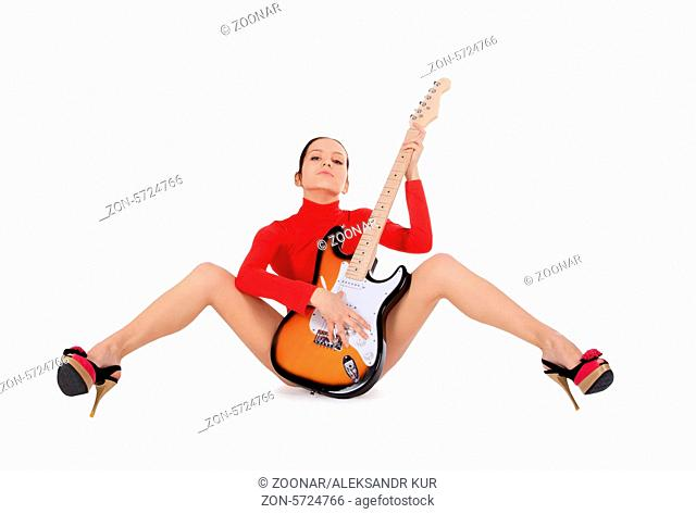 Sexy young female posing with guitar over white