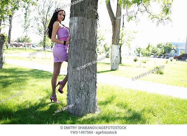 Portrait of 25 year old woman by tree
