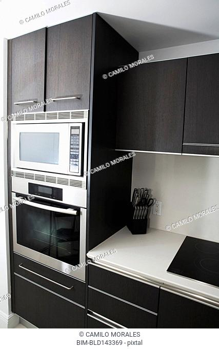 Cabinets, oven and stove in modern kitchen