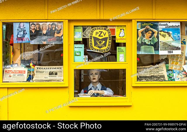 24 July 2020, Saxony-Anhalt, Beuster: A GDR newspaper kiosk with original newspapers and magazines is located on the exhibition grounds of the Blue Light Museum...