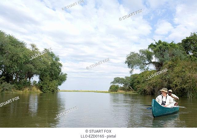 Mature Man in a Canoe on the Zambezi River  Lower Zambezi National Park, Southern Province, Zambezi
