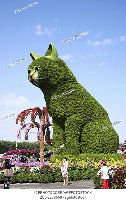DUBAI, UAE, November 2018, Tourist at Dubailand with huge structure of a green cat