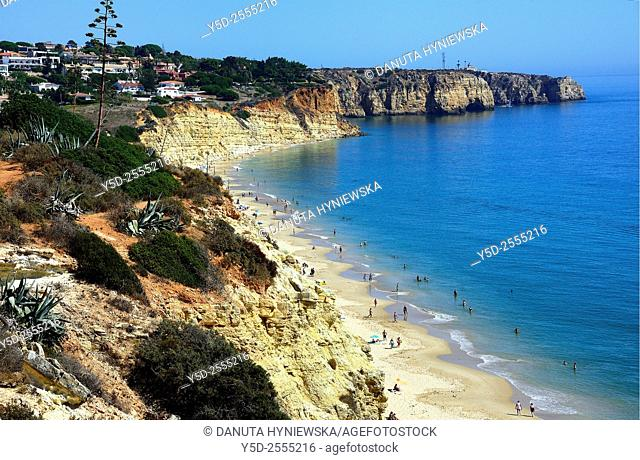 Europe, Portugal, Algarve, Lagos, Porto de Mos beach in foreground, Ponta da Piedade with lighthouse in background