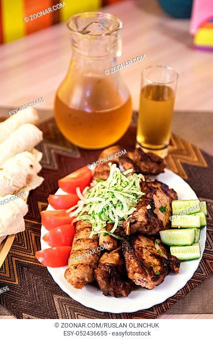 Grilled shish kebab or shashlik meat with vegetables