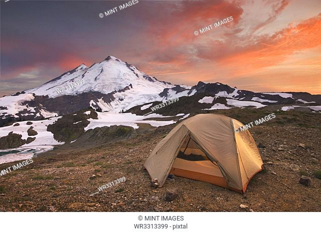Tent at campsite in snowy mountain landscape