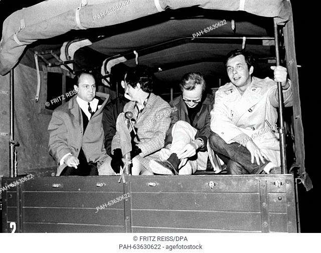 Theatre director Peter Palitzsch (2nd of right) on a police truck after was bitten by a dog which had been rushed onto demonstrators by its owner