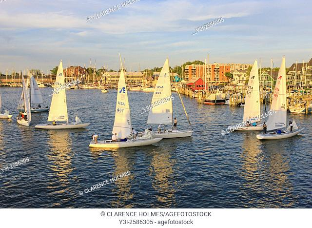 Yachts and sailboats sail on Spa Creek, returning from Wednesday Night Racing activities in Annapolis, Maryland