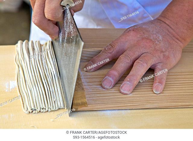 Soba dough being cut into noodles