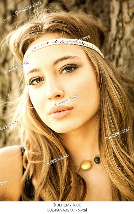 Close up portrait of young woman wearing headband