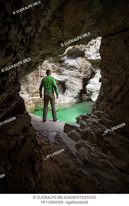 Dolomites, Belluno, Veneto, Italy. Man exploring the gorge of the Soffia waterfall, Mis valley