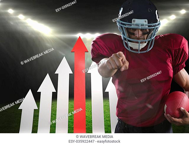 american football player pointing in stadium