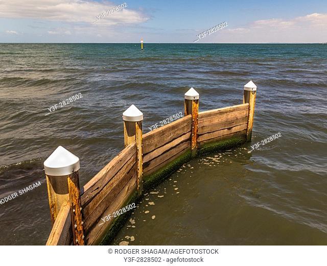A wooden breakwater, St Kilda, Melbourne, Victoria, Australia