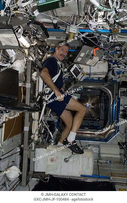 NASA astronaut Dan Burbank, Expedition 30 commander, exercises on the Cycle Ergometer with Vibration Isolation System (CEVIS) in the Destiny laboratory of the...
