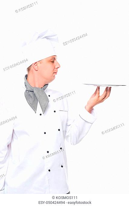 Cook in a suit holding an empty tray on a white background