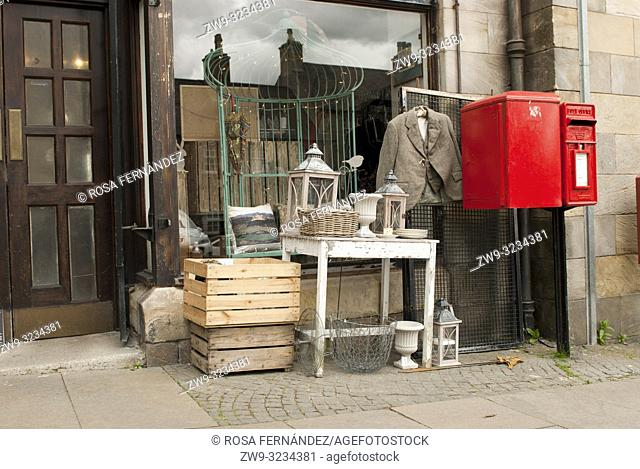 Antiques shop with assorted collectible articles as furniture and decorative items, Stirling, Scotland, United Kingdom
