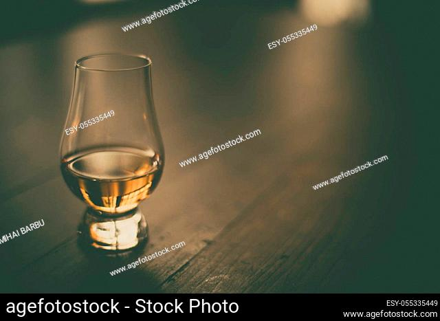 Close up shot of a Glencairn whisky glass, with copyspace to the right