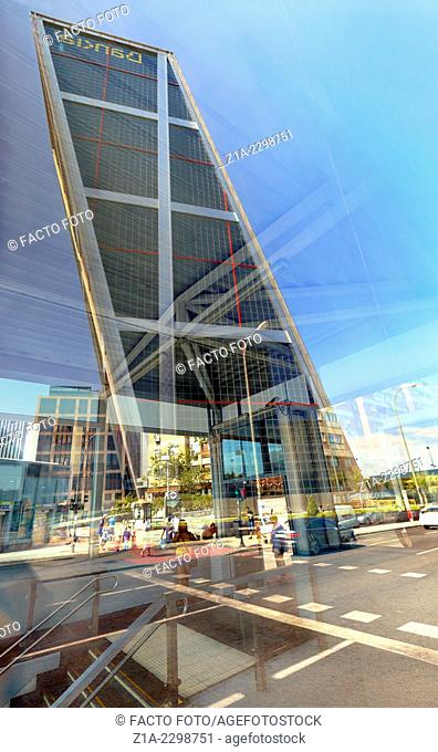 """Reflection of """"""""The Gate of Europe"""""""" towers, also known as KIO Towers, twin office buildings. Madrid, Spain"""