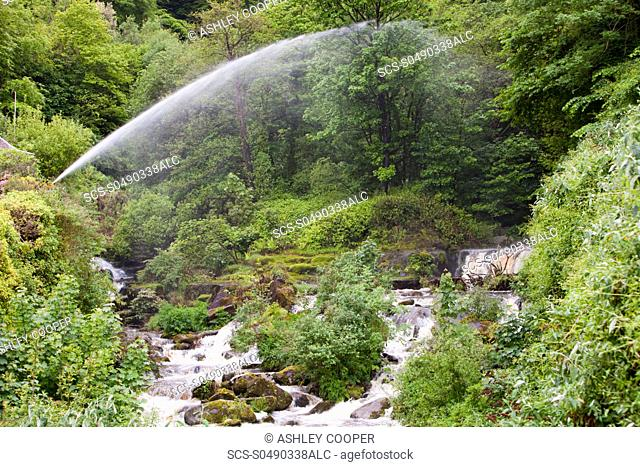 Water spouts below the HEP scheme in glen Lyn Gorge in Devon, UK This is the largest privately owned HEP scheme in the UK