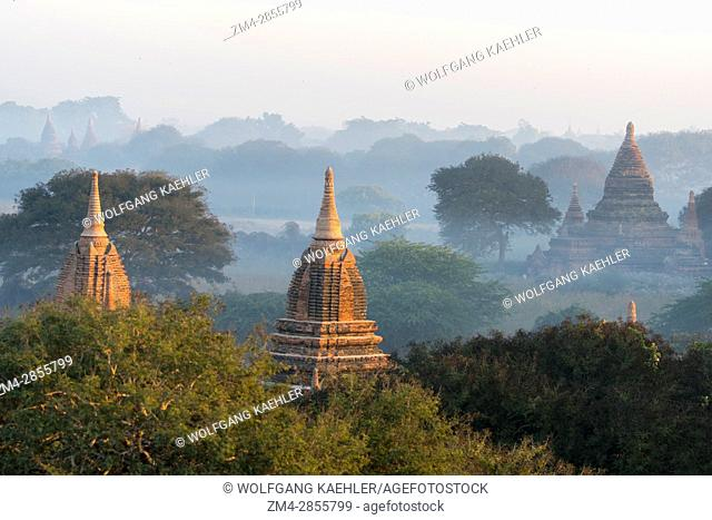 View of smaller temples at sunrise from the Shwesandaw Pagoda in Bagan in Myanmar