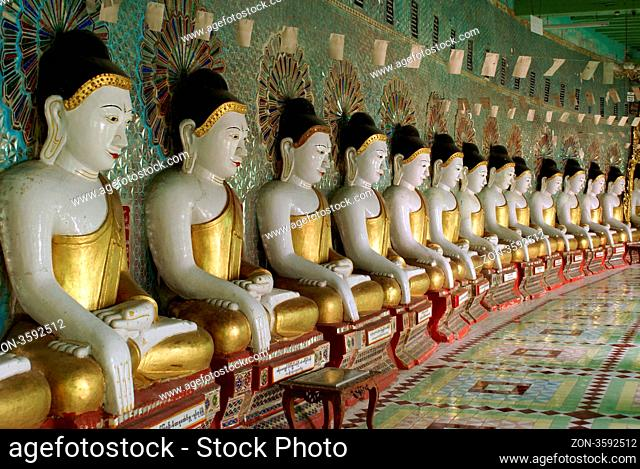 Golden Buddhas in corridor, Sagaing hill, Mandalay, Myanmar