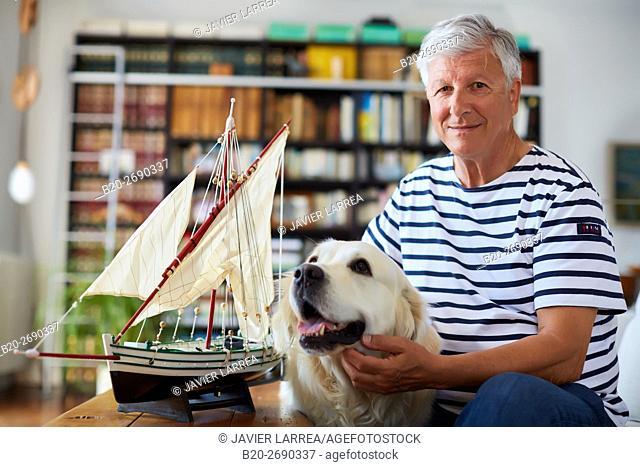 Senior man with dog, 60-70, Model sailboat, Whaleship, Getaria, Gipuzkoa, Basque Country, Spain, Europe