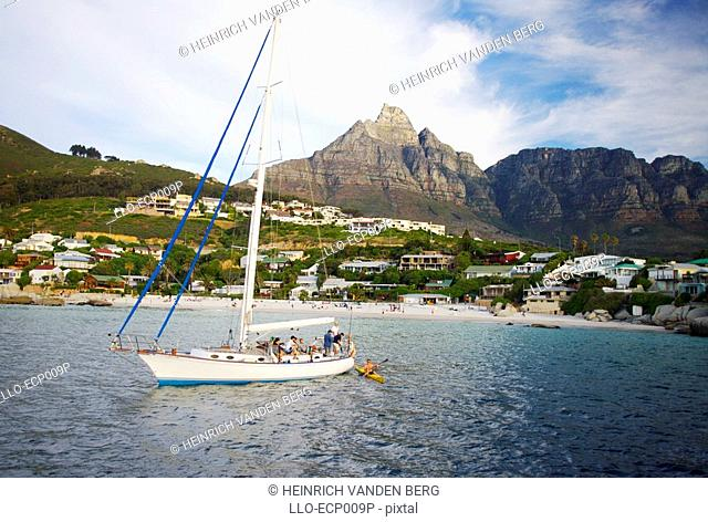 A Sail Boat off Clifton Beach with Table Mountain Behind  Cape Town, Western Cape Province, South Africa