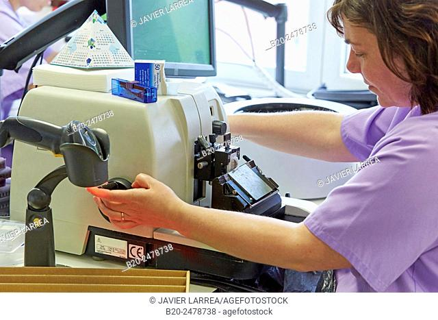 Technician using microtome, Histology, Anatomic Pathology, Hospital Donostia, San Sebastian, Basque Country, Spain