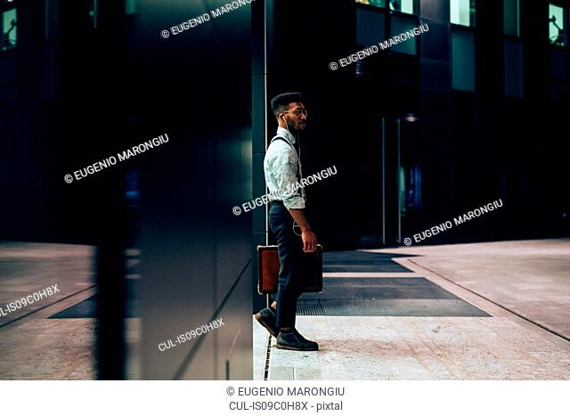 Businessman leaving office building, Milano, Lombardia, Italy