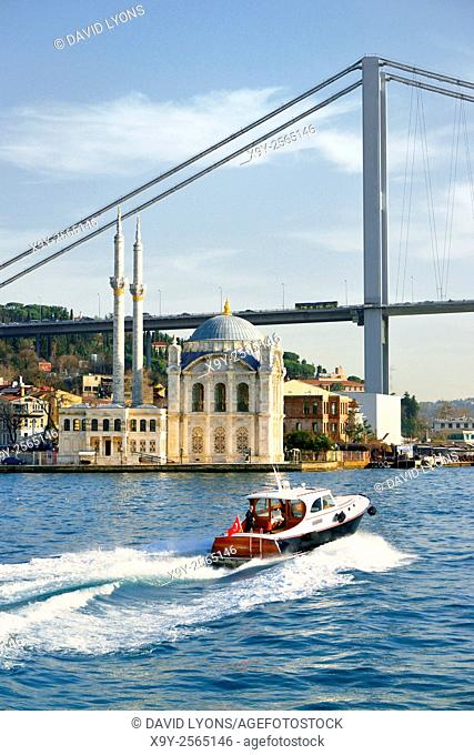 Ortakoy Mosque, Istanbul, Turkey, seen from the Bosphorus. Completed 1856. The First Bosphorus Bridge rises behind