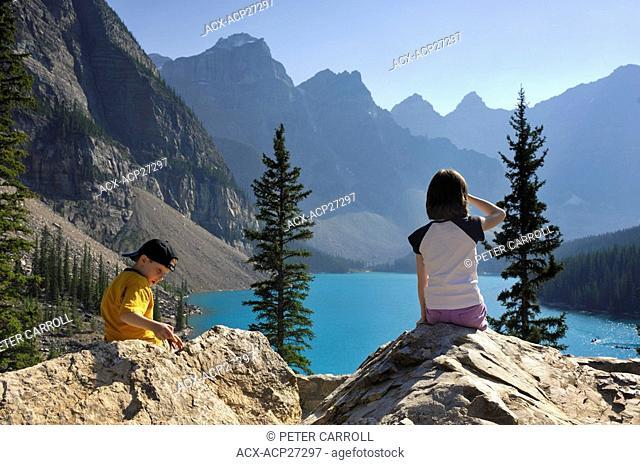 Two children ages 7 & 10 enjoying Moraine Lake, Banff National Park, Alberta, Canada