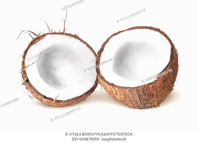 Two halves of coconut lying next isolated on white background