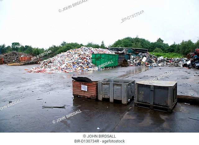 Loose tin plate scrap piled up at scrap metal recycling centre waiting to be sorted and processed
