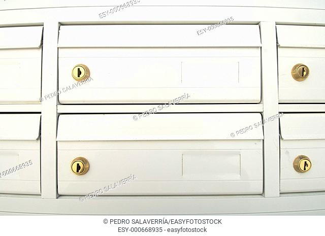 group of white mailboxes in a neighborhood